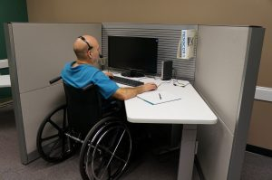 disabled person in wheelchair working on computer